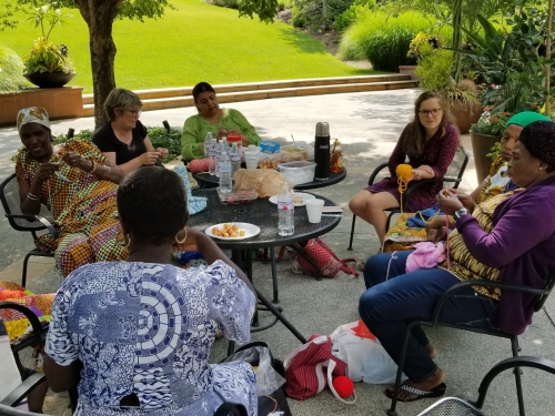 The Utah Health & Human Rights knitting group gathers at Tracy Aviary during the summer of 2018.